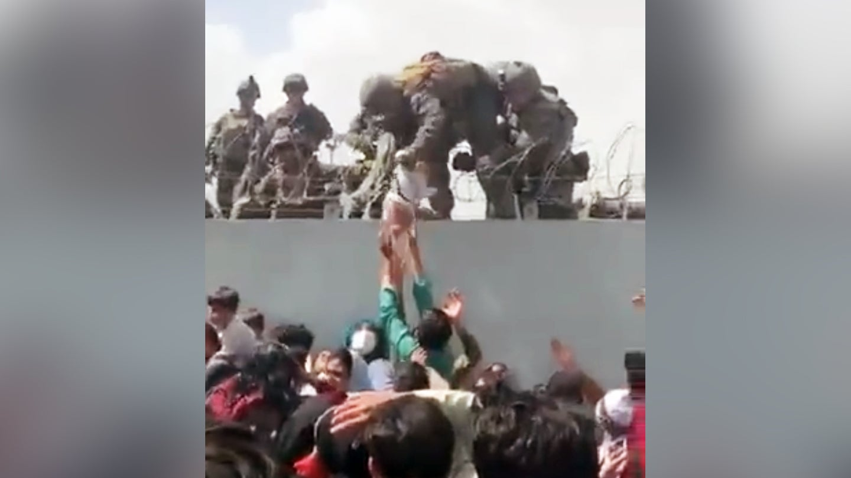 marine with baby kabul