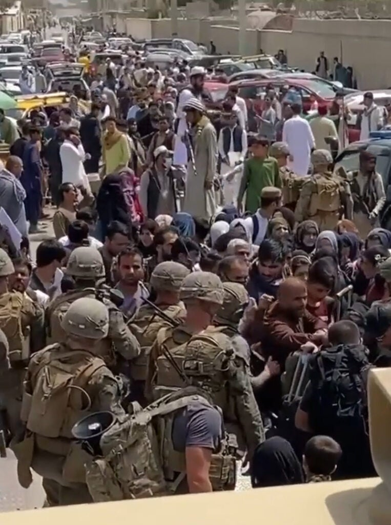 US Marines and Taliban outside Kabul airport are so close they can touch each other